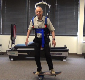 Balance Exercise on Bongo Board with Harness